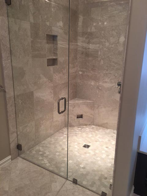 Marble shower installation by professional installers at Bert Henry Carpet & Tile in Tulsa